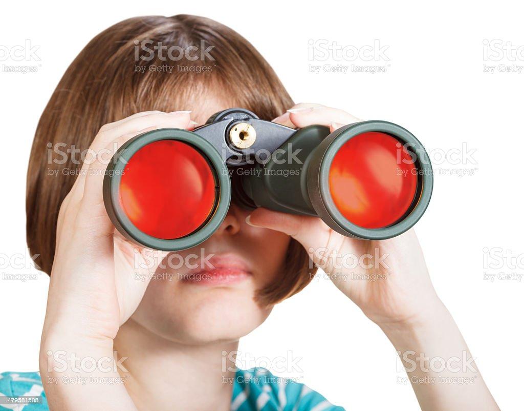 front view of girl looks through binoculars stock photo