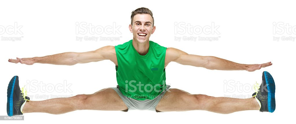 Front view of happy male athlete jumping stock photo