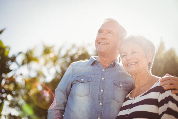 front view of happy senior couple - active seniors stock photos and pictures
