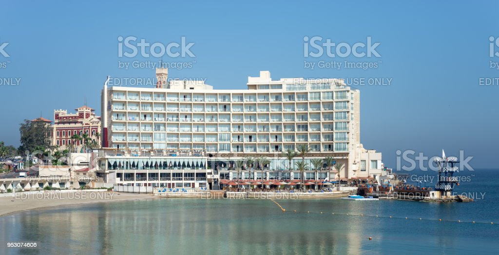Front view of Helnan Palestine Hotel from the sea with clear sky on a summer day, an old hotel located in Al Montazah Park, Alexandria, Egypt stock photo
