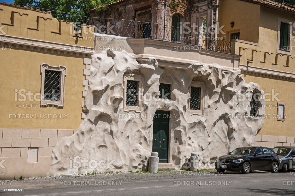 Front view of house with creative and unusual street decor on a sunny day in Rome stock photo