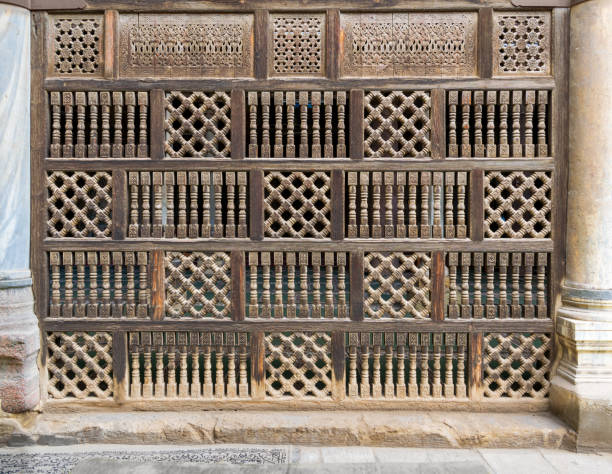 Front view of interleaved wooden arabisk wall - Mashrabiya, Cairo, Egypt stock photo
