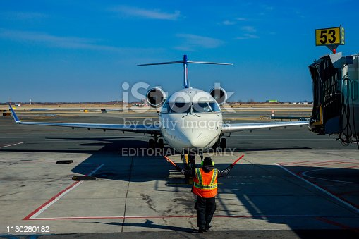186763256 istock photo Front view of landed airplane in a terminal of at the John F. Kennedy International Airport 1130280182