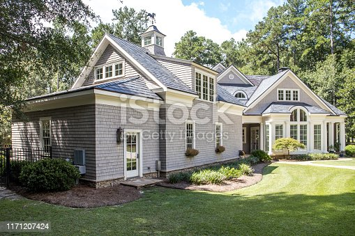 istock Front view of large cape cod style home with custom feautures 1171207424