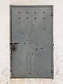 Front view of locked iron door.