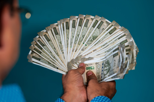 istock Front View of Man Holding Jackpot Money 1171983165