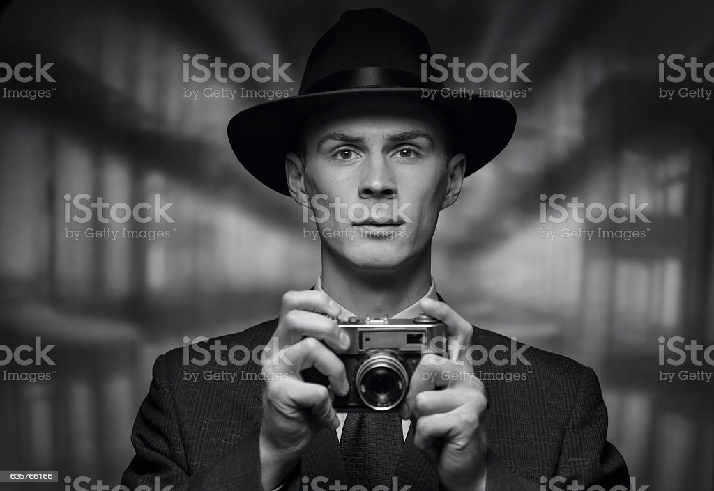 Front view of man holding vintage camera stock photo