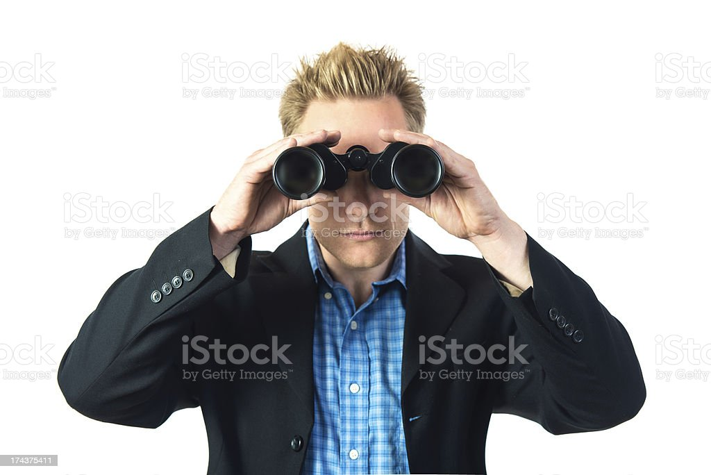 Front view of man looking towards camera with binoculars. royalty-free stock photo