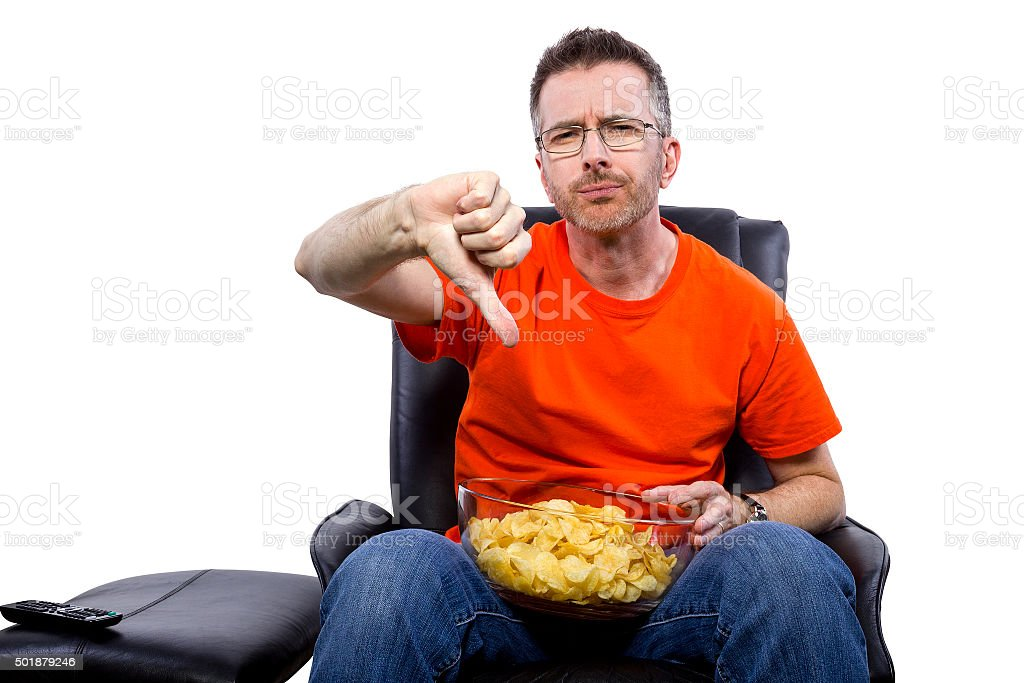 Front View of Man Watching TV with Snacks stock photo