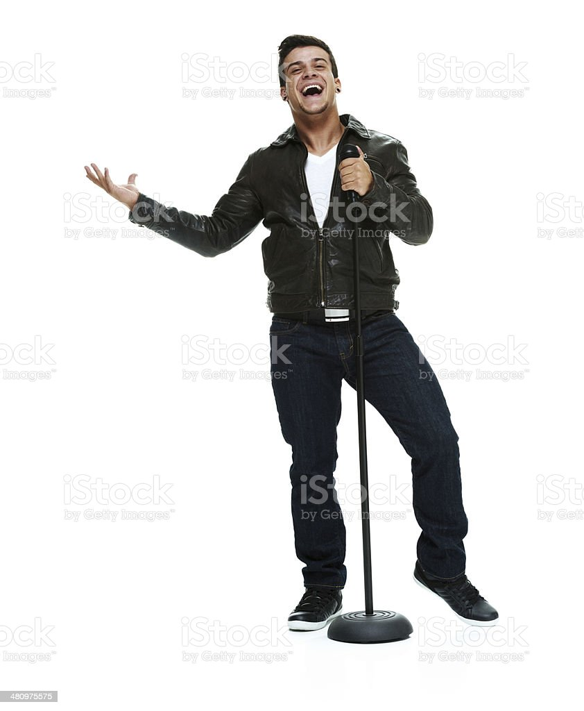 Front view of man with microphone stand stock photo