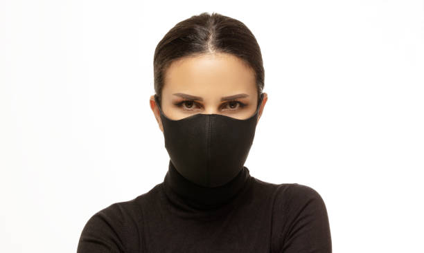 front view of masked woman portrait front of white background - indumento sportivo protettivo foto e immagini stock