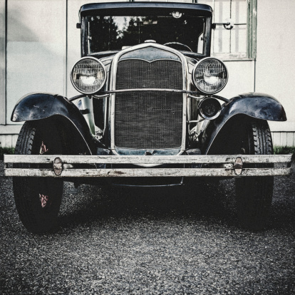 A front view of an old Ford Model T from the 1920's.  Shot in desaturated vintage style.  Square crop.