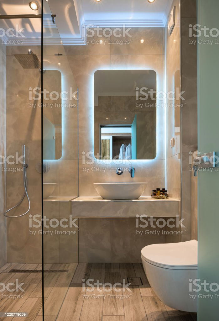 Front View Of Modern Beige Marble Bathroom With Vessel Bowl Sink Mirror Back Light Glass Shower Cabin Wall Hung Toilet Wooden Floor Stock Photo Download Image Now Istock