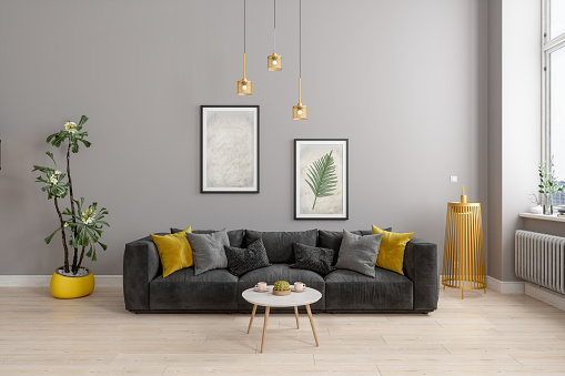 Front View Of Modern Living Room With Yellow Sconce, Gray Sofa And Yellow Pillows