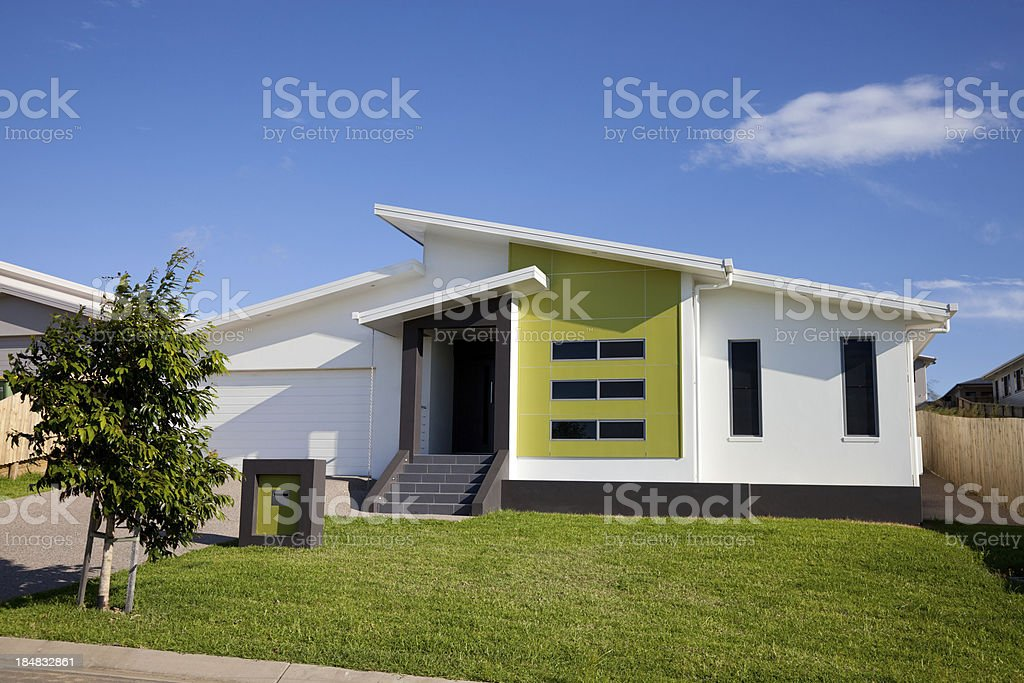 Front view of neat retro-modern family home royalty-free stock photo
