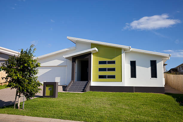 front view of neat retro-modern family home - bungalow stock photos and pictures