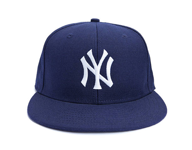 Front View of New York Yankees Ball Cap Taipei, Taiwan - December 17, 2012: This is a studio shot of blue New York Yankees hat made by New Era isolated on a white background. major league baseball stock pictures, royalty-free photos & images