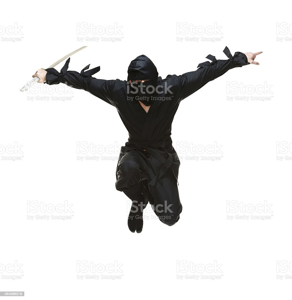 Front view of ninja jumping with sword stock photo