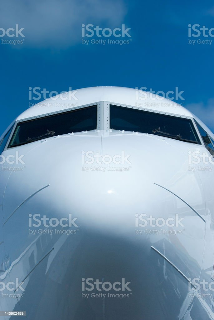 Front view of passenger airplane stock photo