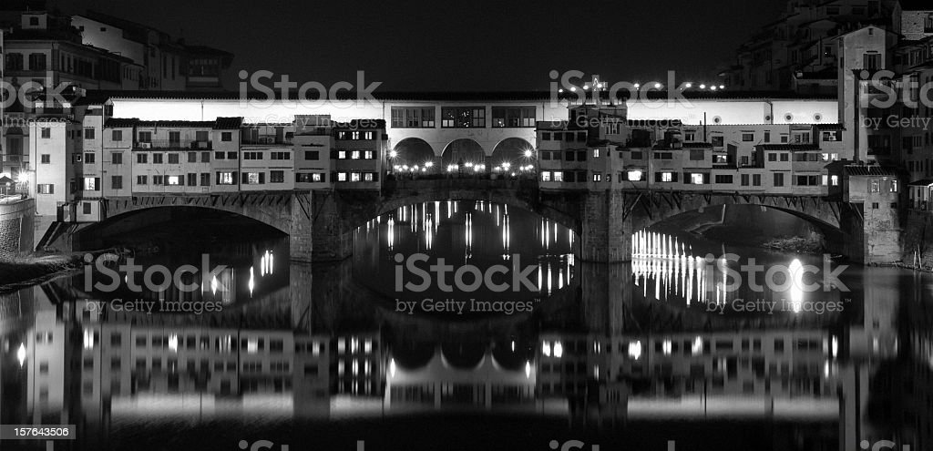 Front view of Ponte Vecchio by night - Italy royalty-free stock photo
