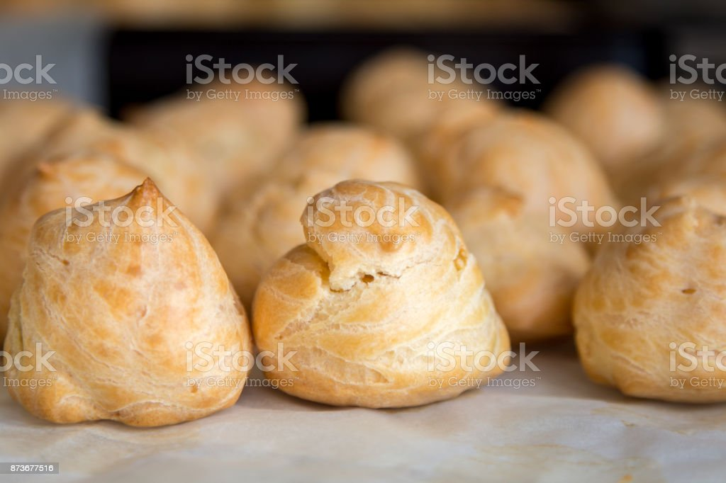 Front view of profiteroles. Appetizing homemade food for breakfast. stock photo