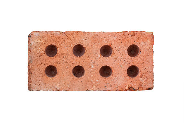Front view of red brick isolated on white background stock photo