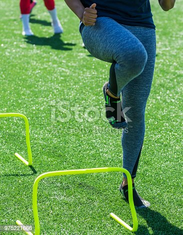 976685710 istock photo Front view of running over mini hurdles 975221666