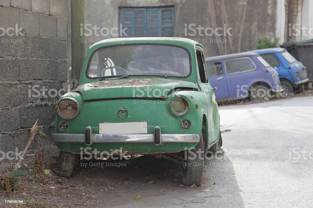 Front View Of Rusty Green Car Wrecks In Nicosia Cyprus Stock