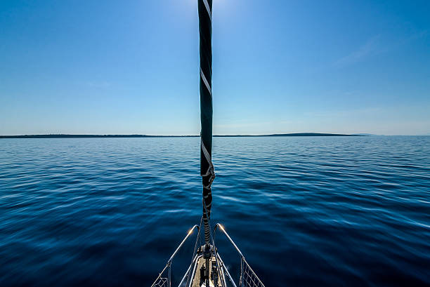 front view of sailing boat on the sea. - yacht front view stock photos and pictures