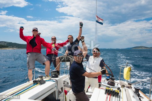 1011210354 istock photo Front view of sailing crew celebrating the victory 500392941