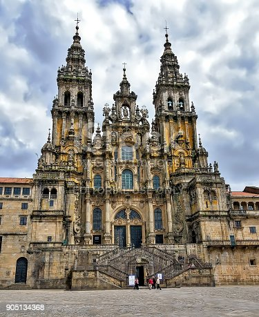 View of landmark Santiago de Compostela cathedral main facade and towers, located in Obradoiro Square. The temple is visited every year by thousands of pilgrims following St James Way.