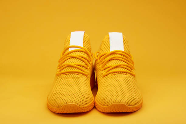 Front view of sport yellow  pair shoes stock photo