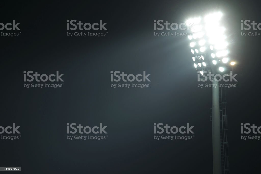 Front view of stadium lights with light beams stock photo