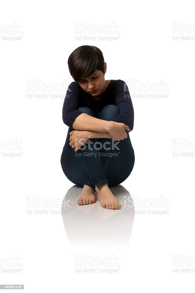 Front View Of Teenage Girl Sitting On Floor And Thinking