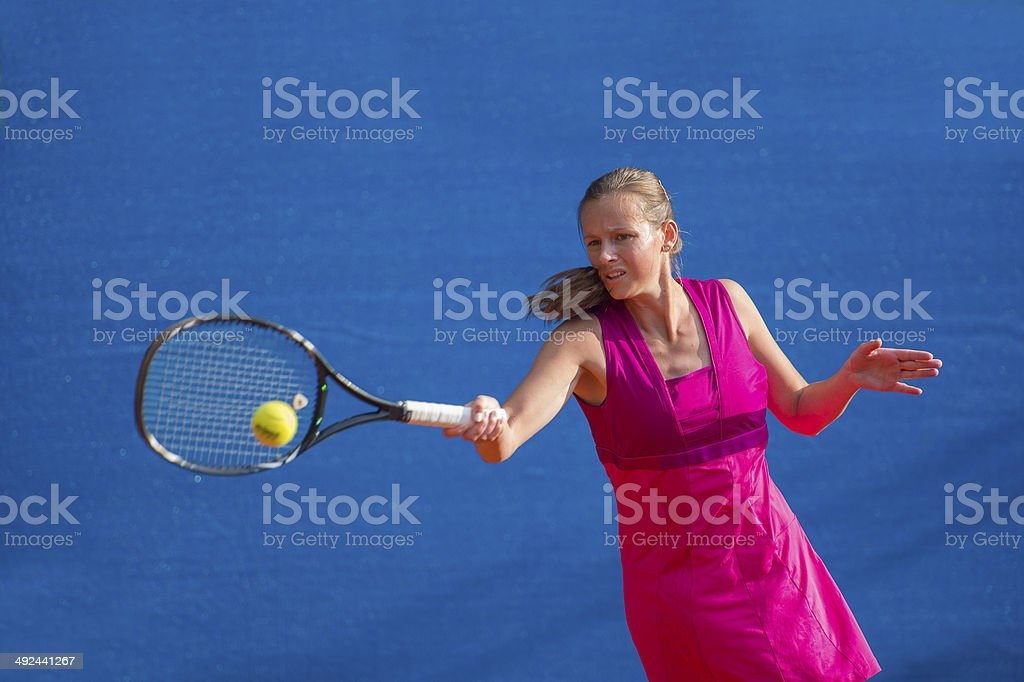 Front View of Tennis Player at Forehand Drive stock photo