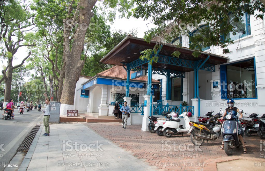 Front view of the brand of ANZ commercial bank - an old house near Hoan Kiem (Sword) lake in Hanoi capital stock photo