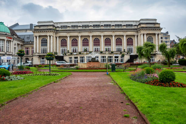 Front view of the present building of the large Kursaal, the ballroom of the 18th-century La Redoute - the oldest Casino in the world with the Gardens of the Casino in front Spa, Belgium - June 12, 2016: Front view of the present building of the large Kursaal, the ballroom of the 18th-century La Redoute - the oldest Casino in the world with the Gardens of the Casino and the fountain in front spa belgium stock pictures, royalty-free photos & images