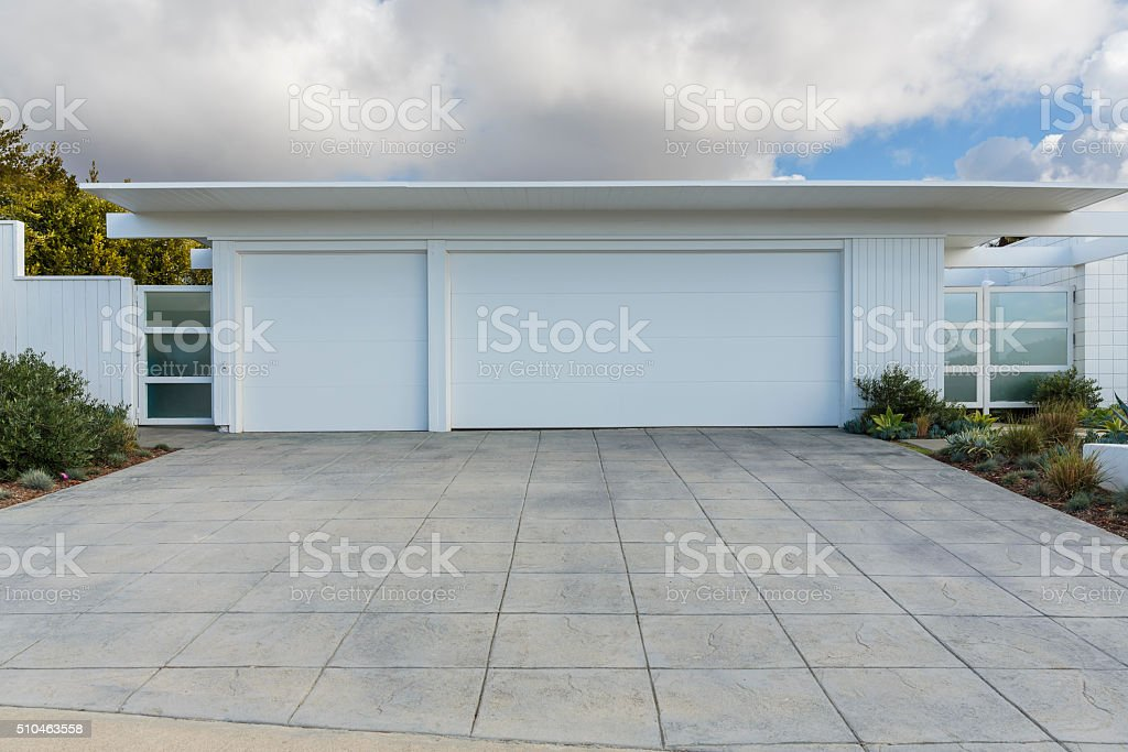 front view of three car garage door stock photo