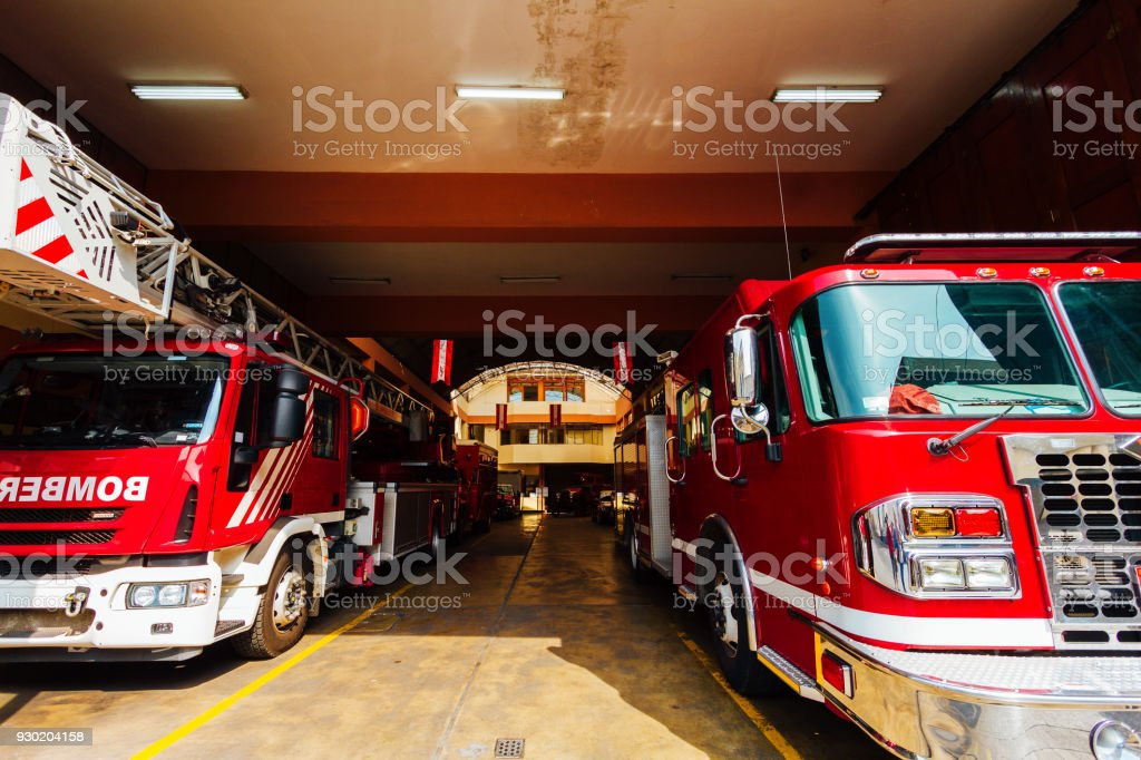 Front view of two fire engines in fire station of Lima, Peru