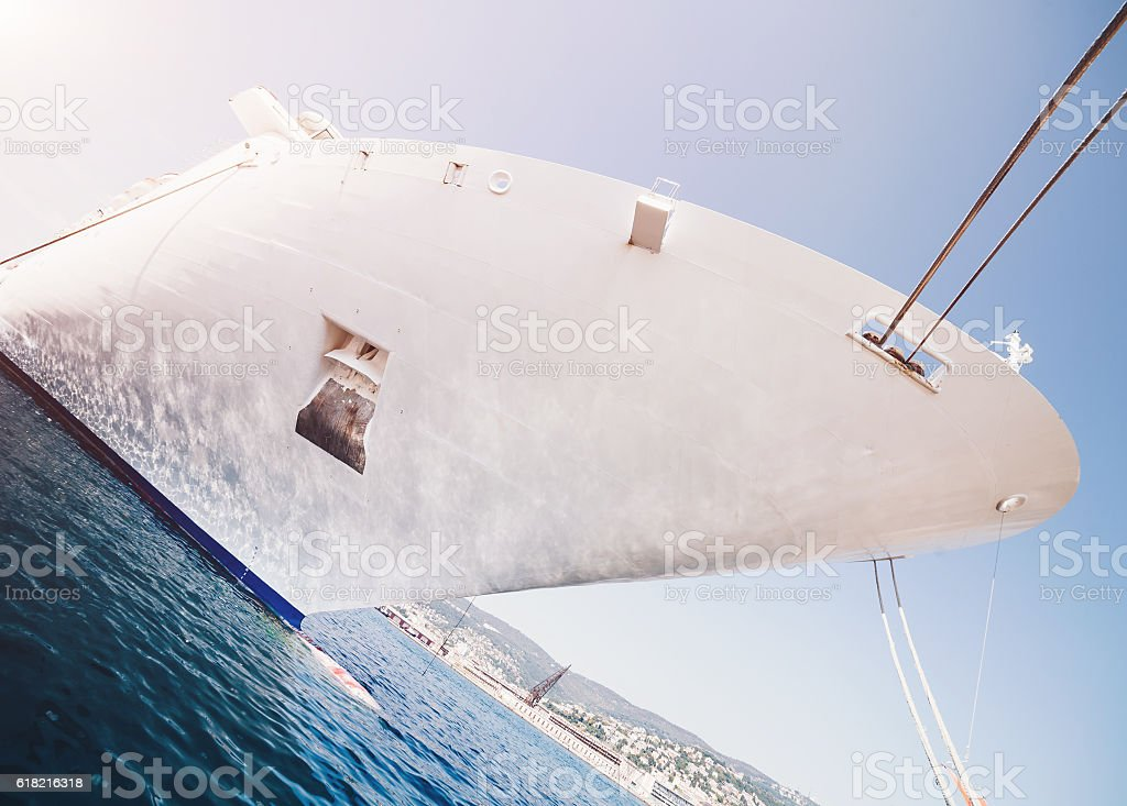 Front view of white cruise ship in the harbor stock photo