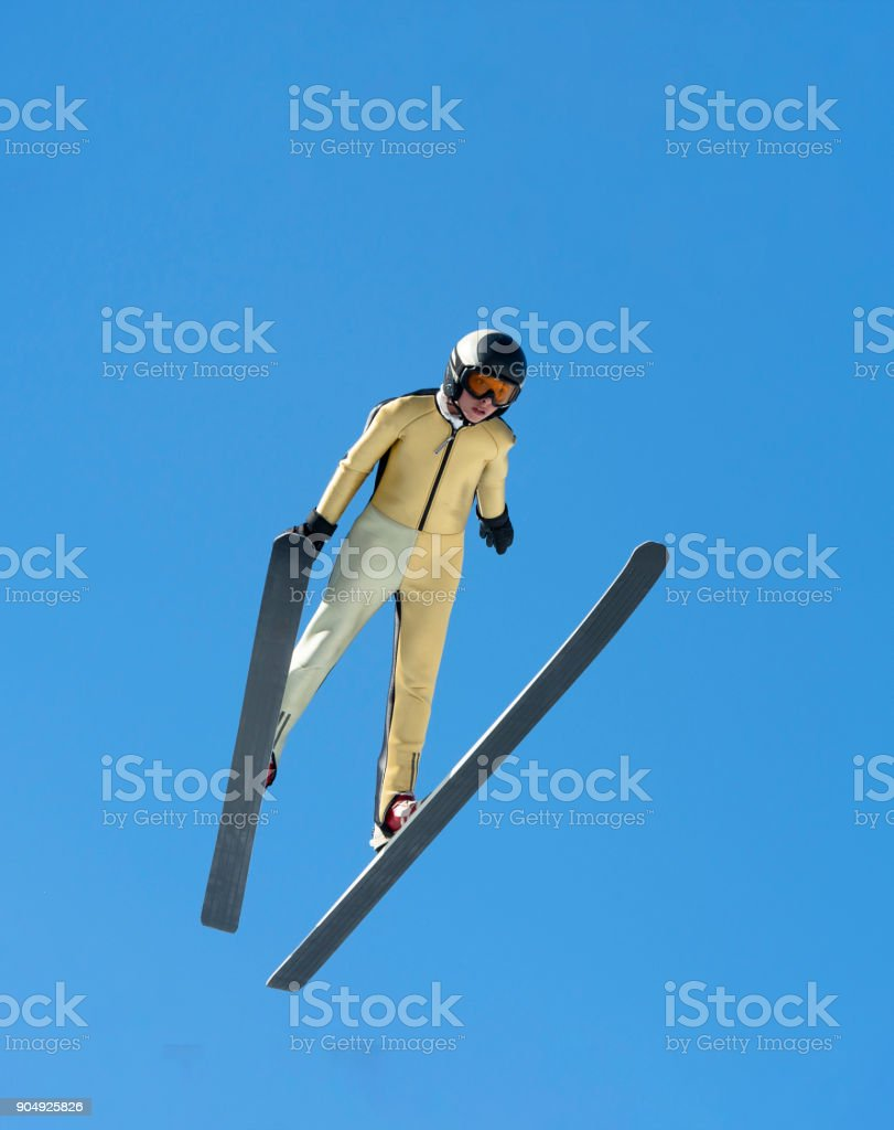 Front View of Young Male Ski Jumper Practicing at 30 m Hill stock photo