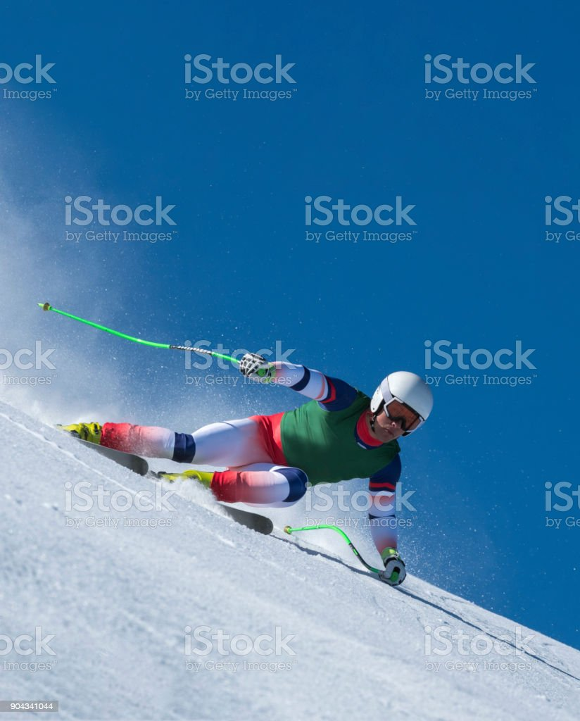 Front View of Young Male Skier at Downhill Ski Training Against the Blue Sky stock photo