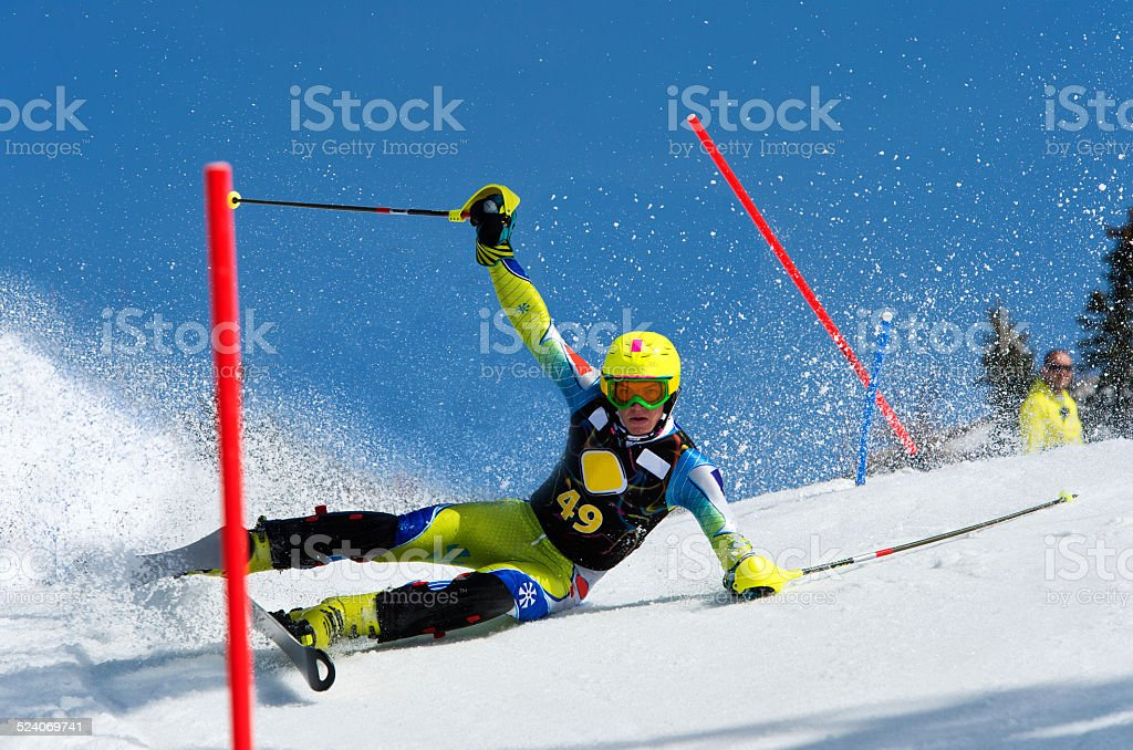 Front View of Young Man Sliding During Slalom Ski Race stock photo