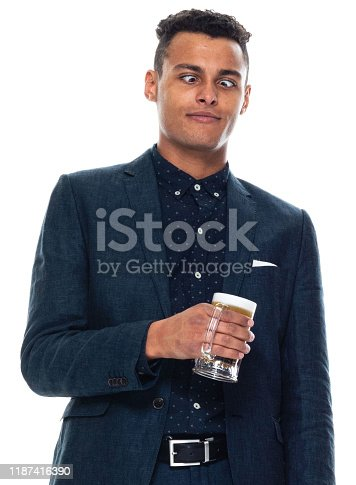 istock Front view / one man only / one person / waist up / portrait of 20-29 years old adult handsome people black hair / short hair african ethnicity / african-american ethnicity male / young men businessman / business person wearing a suit / pale ale 1187416390