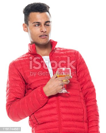 istock Front view / one man only / one person / waist up / portrait of 20-29 years old adult handsome people black hair / short hair african ethnicity / african-american ethnicity male / young men standing who is drinking / drunk / cool attitude 1191744551