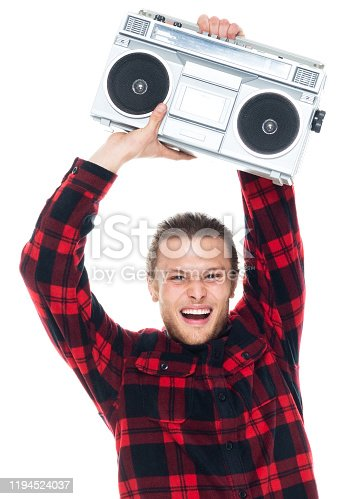 Front view / one man only / one person / waist up / portrait of 20-29 years old adult handsome people blond hair caucasian male / young men dancing / exercising wearing lumberjack shirt / plaid shirt / button down shirt / shirt / pants who is smiling / happy / cheerful / laughing / joy / listening and holding boom box / personal stereo / tape recorder / music / old-fashioned / party - social event