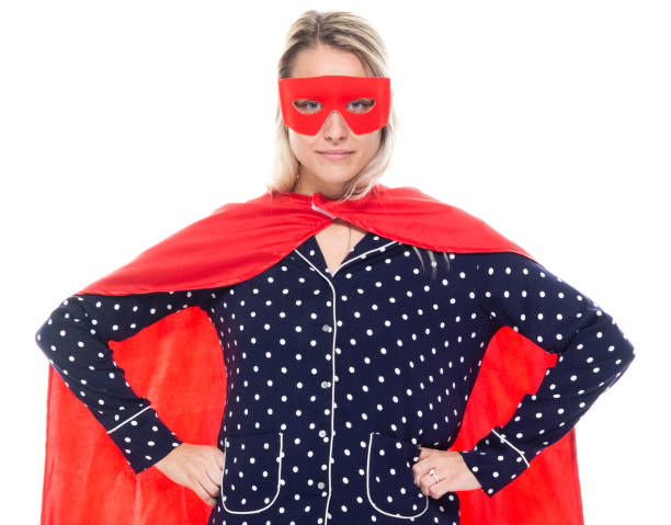 Front view / one person / waist up / portrait of 20-29 years old adult beautiful blond hair / long hair caucasian female / young women superhero / heroines / hero / superwoman standing / cool attitude who is courage stock photo