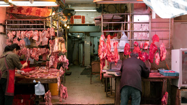 Front view open air Chinese butcher market stall stock photo