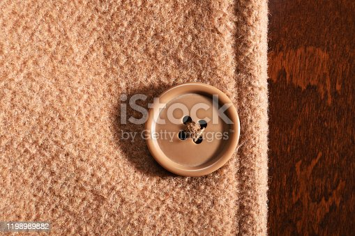 Front view overcoat or jacket button