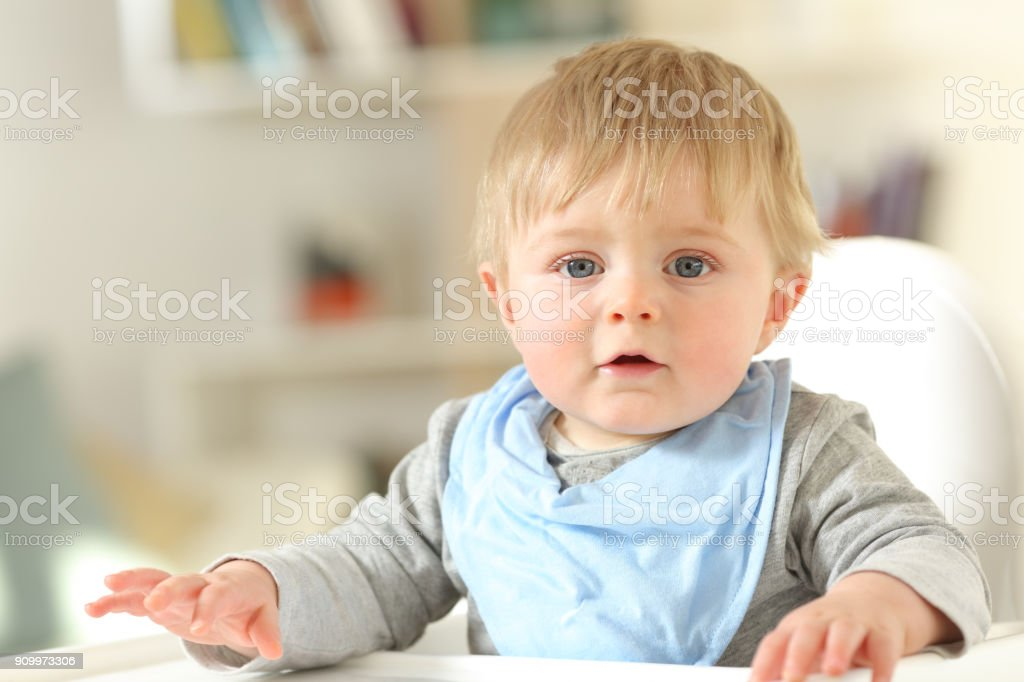 Front view portrait of a baby looking at camera stock photo